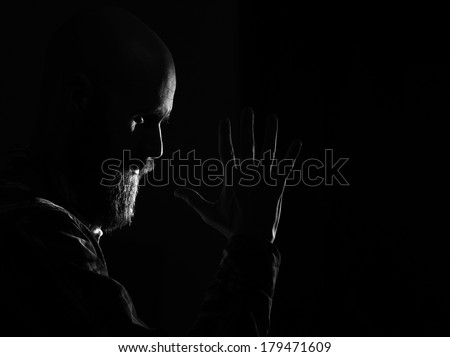 bearded man praying - stock photo