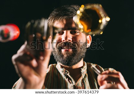 Bearded man preparing cocaine line on mirror representing the concept of  people abusing drugs - stock photo