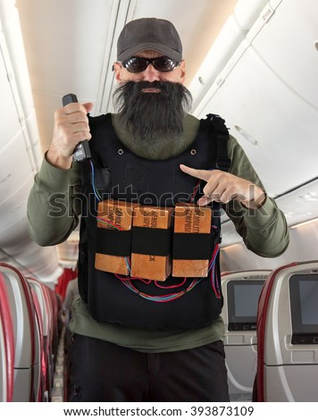 Bearded man terrorist threatens the plane with vest of explosives - stock photo