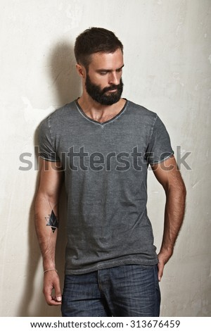 Bearded man wearing grey blank t-shirt - stock photo