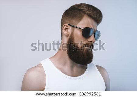 Bearded man wearing sunglasses. Studio shot on white background - stock photo