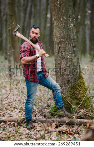 bearded man with an ax - stock photo