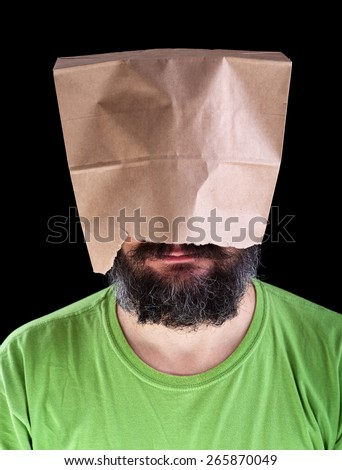 Bearded man with paper bag on his head wearing a smile - ignorance is bliss concept - stock photo