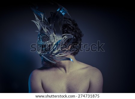 bearded man with silver mask Venetian style. Mystery and renaissance - stock photo