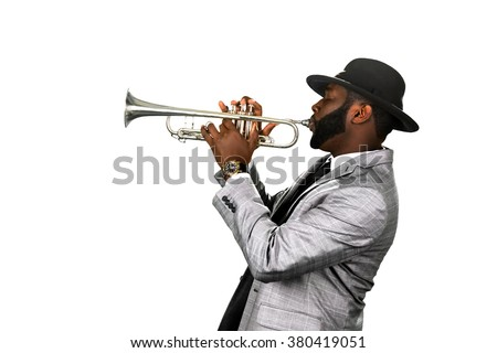 Bearded musician. Classy jazzman. A gifted trumpet player. Stylish musician with a trumpet. - stock photo