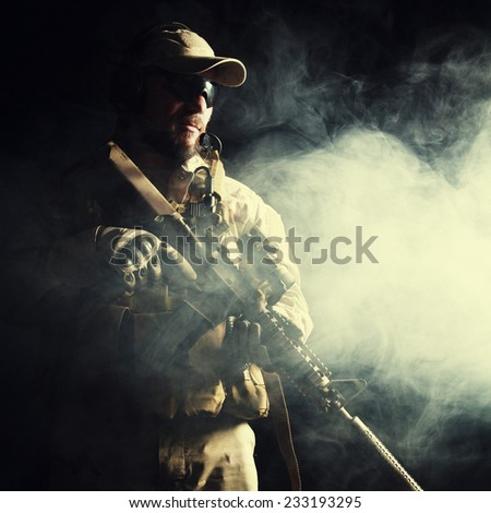 Bearded special forces soldier on dark background - stock photo
