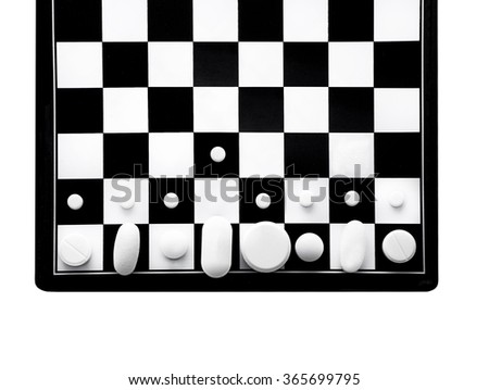 beat the disease. the concept of the fight against the disease. Chessboard and pills symbolize strategy for treating patients. Isolated on white background - stock photo