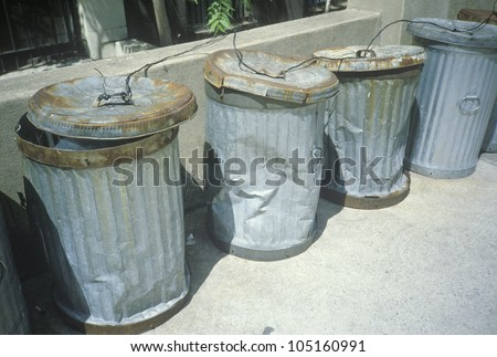 Beaten and dented New York trash cans - stock photo