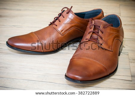 Beatiful pair of brown luxurious men's leather shoes.