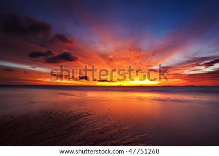 Beatiful sunset in the tropical sea - stock photo