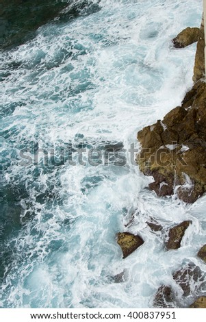 beating the rock sea wave. extreme sports - stock photo
