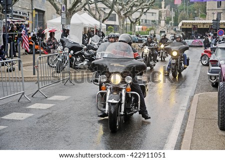 BEAUCAIRE, FRANCE - APRIL 30: Bikers driving in heavy rain for a gathering of American motorcycles in Beaucaire in the French department of Gard, april 30, 2016
