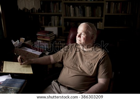 BEAUFORT, SOUTH CAROLINA, USA-SEPTEMBER 17, 2015: Author Pat Conroy sits in his study with his books. Conroy passed away March 4, 2016. - stock photo