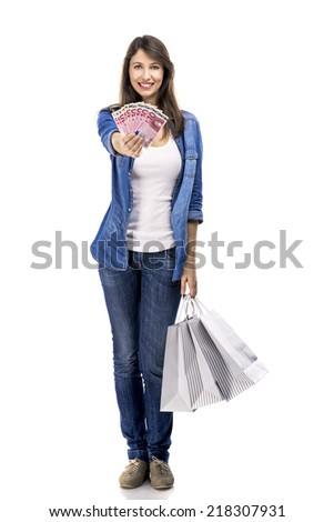 Beauitful woman holding shopping bags and some Euro currency notes, isolated over white background - stock photo