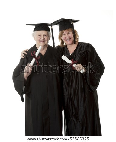 Beauitiful Caucasian mother and daughter in black graduation gowns isolated on a white background