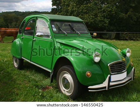 BEAULIEU, FRANCE - JULY 23: (Ed Note: License Plate Altered) A green citroen 2 CV on show on July 23, 2007 in Beaulieu, France. The 2CV is not longer in production and considered a collector's piece.  - stock photo