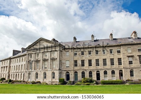 BEAUMARIS, UK - AUGUST 13: Victoria Terrace on August 13, 2013 in Beaumaris. Victoria Terrace was designed in 1833 by Joseph Hansom (of Hansom Cab fame)  & is a Grade 1 listed building. - stock photo