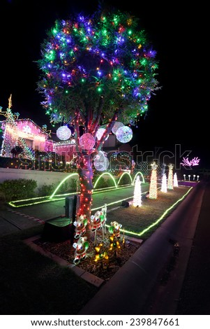 BEAUMONT HILLS, AUSTRALIA - DECEMBER 24, 2015;  Christmas lights decorations on house and gardens create a joyful wonderland and  draw crowds of visitors each year with over 60000 lights - stock photo