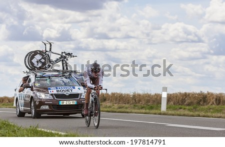 BEAUROUVRE,FRANCE,JUL 21:The French cyclist Maxime Bouet from Ag2r-La Mondiale Team pedaling during the 19 stage- a time trial between Bonneval and Chartres on July 21 2012. - stock photo
