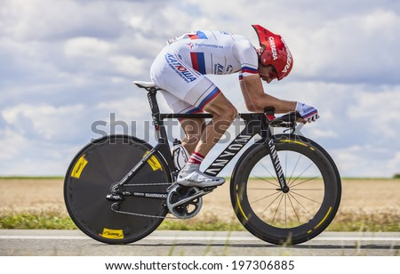 BEAUROUVRE,FRANCE,JUL 21:The Russian cyclist Denis Menchov from Team Katusha, pedaling during the 19 stage- a time trial between Bonneval and Chartres on July 21 2012 - stock photo