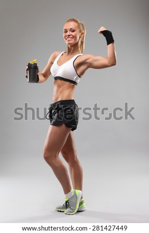 beaury fitness girl drinking a sports drink - stock photo