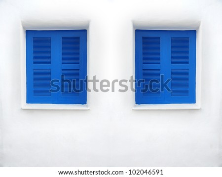 Beaut Blue window on white wall - stock photo