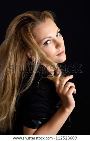 Beauteous woman posing on a black background