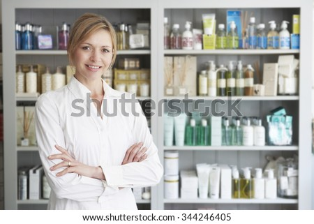Beautician Advising On Beauty Products - stock photo