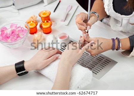 Beautician applying gel - stock photo