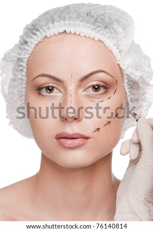 Beautician touch and draw correction lines on woman face. Before plastic surgery operetion. Isolated