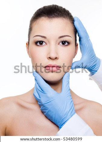 beautician touching attractive health woman face. Plastic  surgery.  Isolated on white - stock photo
