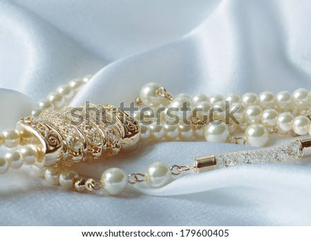 Beautifu ljewel  pearls on  background  - stock photo