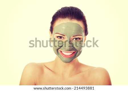 Beautifu toplessl woman with facial mask. Spa concept. Isolated on white. - stock photo