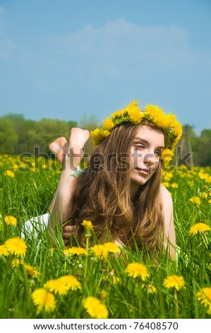 beautifu youngl girl relaxing on a meadow