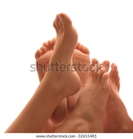 Beautiful a foot of three girls, isolated on a white background, please see some of my other parts of a body images - stock photo