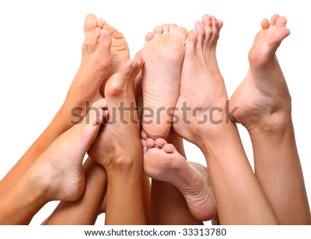Beautiful a foot of three girls, isolated on a white background, please see some of my other parts of a body image - stock photo