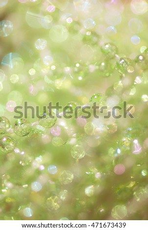Beautiful abstract background from green beads with a boke