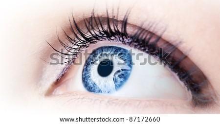 Beautiful abstract blue eye, extreme closeup - stock photo
