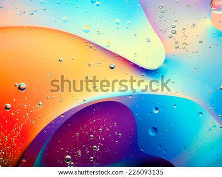 beautiful abstract colorful background with oil on water surface - stock photo