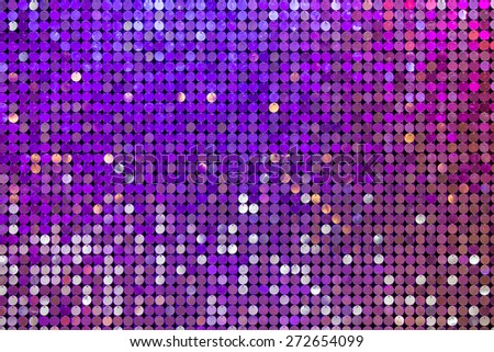 Beautiful abstract sparkles glitter background. Glittering sequins on the wall - stock photo