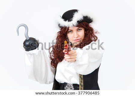 Beautiful actress in pirate costume with pistol and hook - stock photo