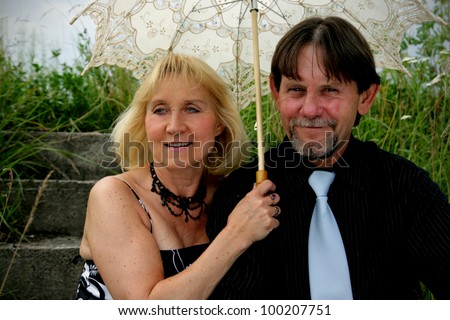 Beautiful adult couple portrait in woods