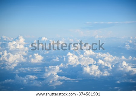 Beautiful aerial view of blue sky and white clouds, view from airplane's window - stock photo