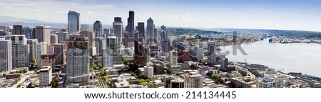 Beautiful aerial view of Seattle's downtown skyline including business development, sports stadiums, new construction, and especially the Port of Seattle and large container ship harbor operation.  - stock photo