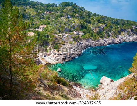 beautiful aerial view of the beach Cala de Deia with azure sea, Mallorca, Spain - stock photo