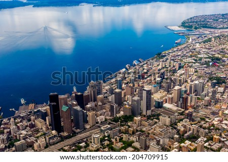 Beautiful Aerial View of the Pacific Northwestern City of Seattle, Washington, USA.  Downtown Metropolitan Area with Puget Sound.  - stock photo