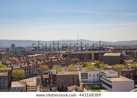 Beautiful aerial view on Dublin with a spire on the horizon.