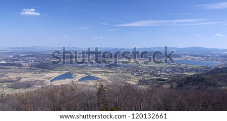 Beautiful aerial view on lakes, fields and mountains - stock photo