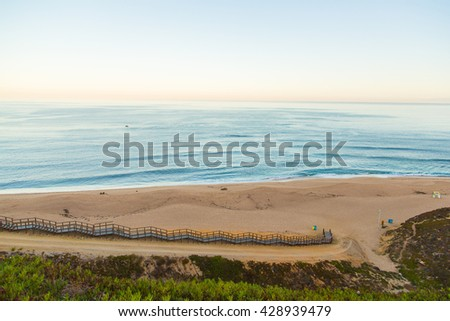 Beautiful aerial view on surfers going to the beach with surf boards.  - stock photo
