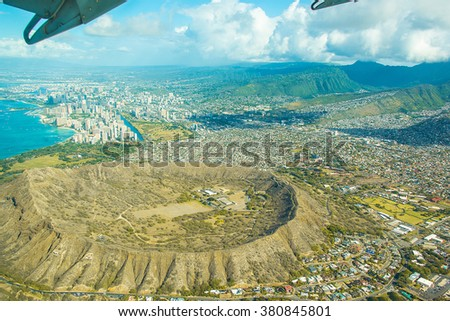 Beautiful aerial view on the island of Hawaii on the diamond head from the sea plane. - stock photo